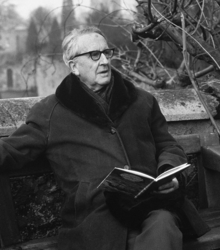 JRR Tolkien posing with one of his best seller books